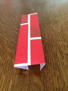 Folded along a pair of parallel mirror lines